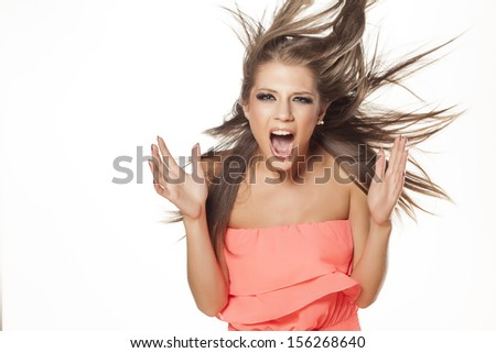 attractive beautiful girl in a dress posing with wind in her hair on white background - stock photo