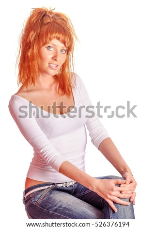 Attractive  beautiful sexy redhead woman sitting isolated on white