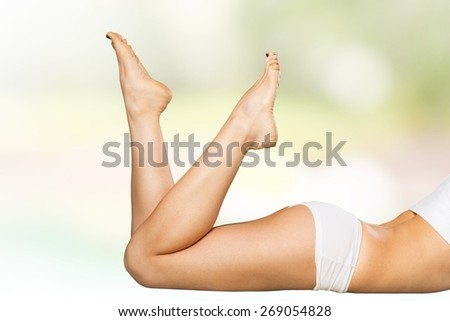 Attractive. Beautiful slender female legs on a white background - stock photo