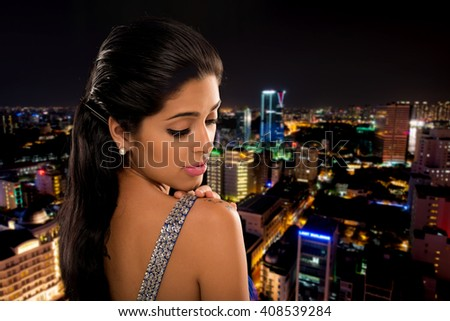 Attractive beautiful woman  looking at tattoo on her shoulder - stock photo