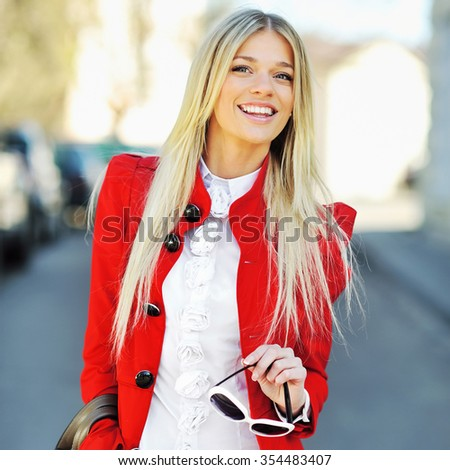 Attractive beautiful woman with handbag and sunglasses