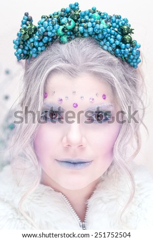 Attractive beautiful woman with massive berry branches headband portrait  - stock photo