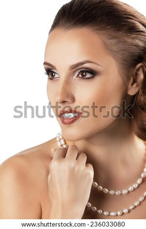 attractive beautiful woman with pearls jewerly. glamour vogue style portrait. - stock photo