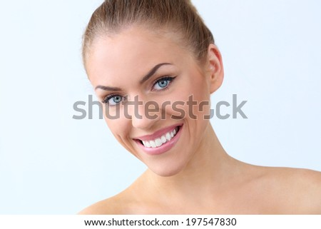Attractive, beautiful woman with wide smile - stock photo
