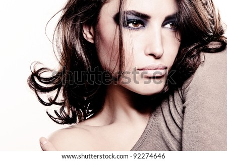 attractive beauty portrait of a young woman with strong makeup - stock photo