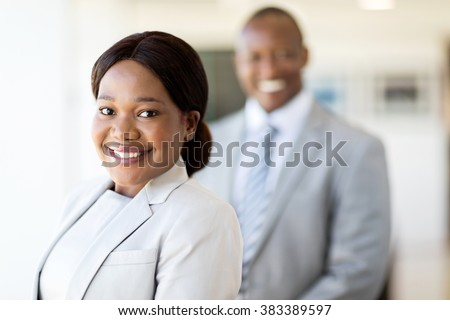 attractive black business woman looking at the camera