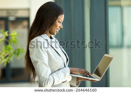 attractive black business woman working on laptop in office