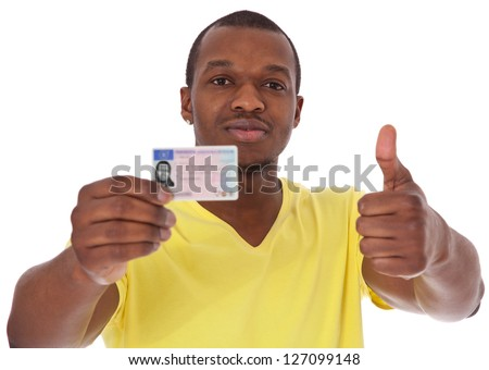 Attractive black guy proudly showing his driver license. All on white background. - stock photo