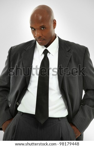 Attractive Black Male Model In A Suit Looking At The Camera - stock photo