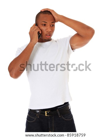 Attractive black man gets shocking news during phone call. All on white background. - stock photo