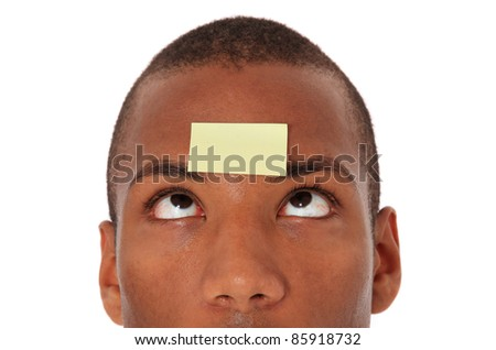 Attractive black with blank post-it note on his forehead. All on white background. - stock photo