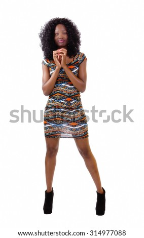 Attractive Black Woman Standing In Patterned Dress
