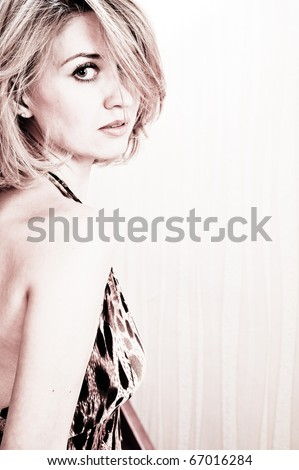 Attractive blond beauty with light background
