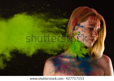 attractive blond girl in colors Holi