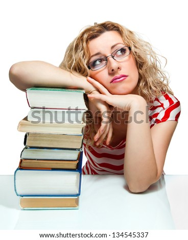 Attractive blond hair woman with books on white background