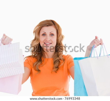 Attractive blond-haired woman showing her shopping