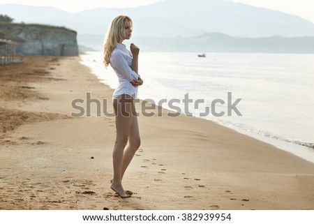 Attractive blond lady on the tropical beach - stock photo