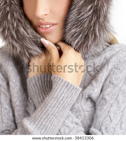 Attractive blond wearing fur hat isolated on white