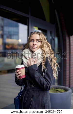 attractive blond woman drinking coffee - stock photo