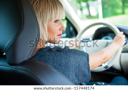 attractive blond woman driver in her car