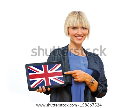 attractive blond woman holding tablet with united kingdom flag on screen