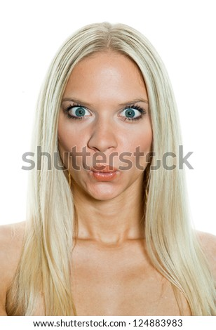 attractive blond woman making funny face grimace