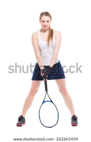 Attractive blond woman posing with tennis racket. Isolated on white