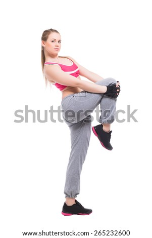 Attractive blond woman training in sportswear. Isolated on white
