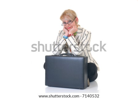 Attractive blond young businesswoman with suitcase, pensive look.  White background, studio shot.