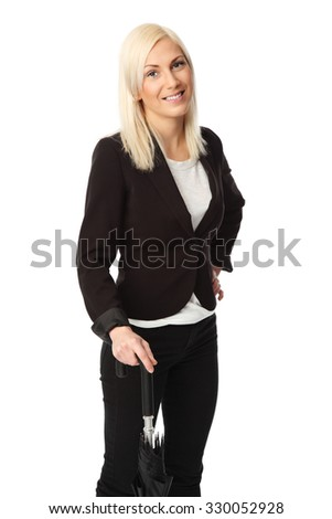 Attractive blonde businesswoman in her 20s standing wearing a suit and a white shirt, holding an umbrella. White background. - stock photo
