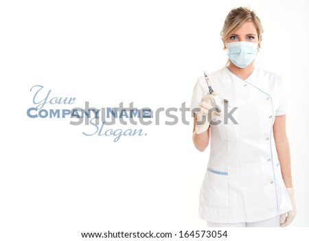 Attractive blonde female dentist holding a syringe  - stock photo