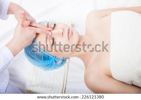 Attractive blonde getting relaxing massage of a head