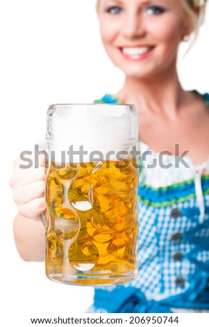 attractive blonde girl in a dirndl with a beer - stock photo