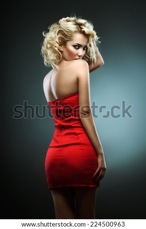 Attractive blonde in a red (green background)