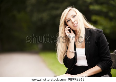 Attractive Blonde with mobile phone - stock photo