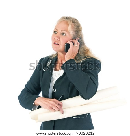 Attractive blonde woman architect talking on her cellphone to a client. Isolated on a white background.