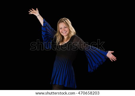 Attractive blonde woman in a blue dress with outstretched arms