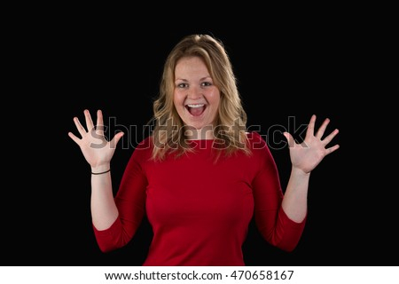 Attractive blonde woman shows hands in surprise