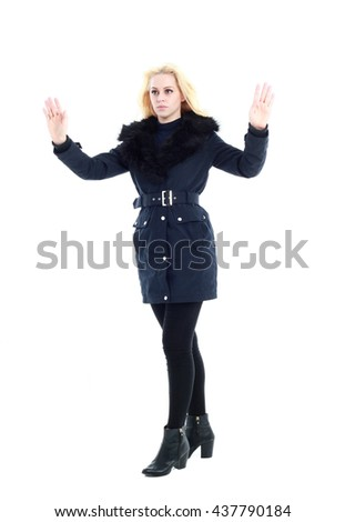 attractive blonde woman wearing dark winter coat with fur collar and boots. standing pose, isolated on a white background. - stock photo