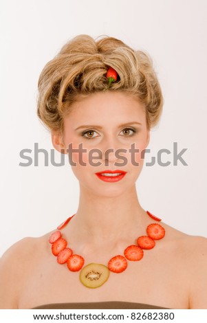 Attractive blonde woman with a chain around his neck from fruit /Attractive Blonde Inside