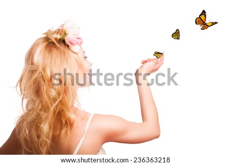 attractive blonde woman with butterflies - stock photo