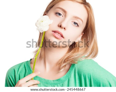 Attractive blonde woman with perfect skin and buttercup near face.Close-up. Isolated.