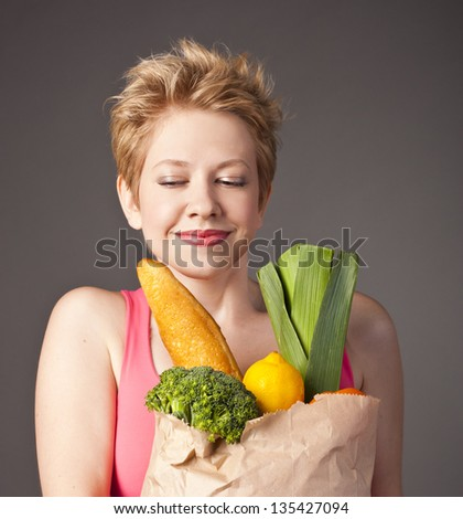 attractive blonde woman with vegetables
