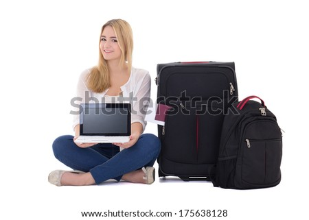 attractive blondie woman with suitcase and laptop sitting isolated on white background - stock photo