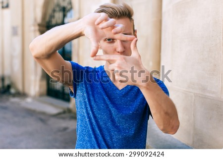 Attractive blue eyed, blond young man on the street