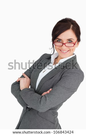 Attractive blue eyed secretary with folded arms against white background