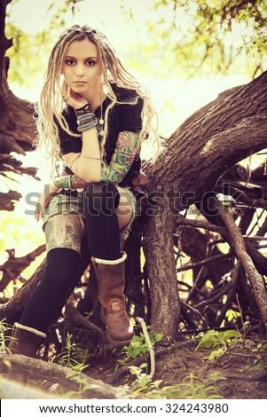 Attractive boho style girl in the wild wood. Boho, hippie fashion shot. - stock photo