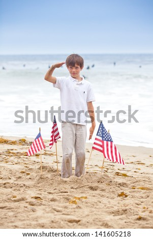 Attractive boy with American Flags on the beach in Malibu California - stock photo