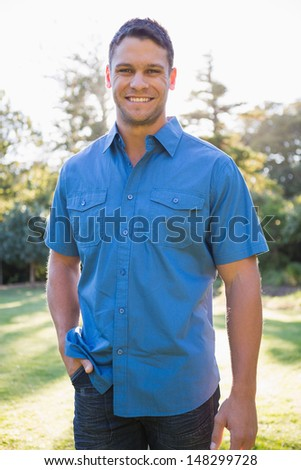 Attractive brown haired man smiling - stock photo