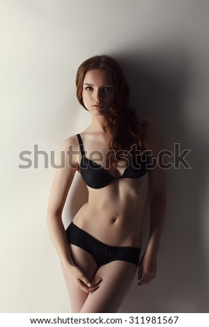 Attractive brown haired model advertises underwear